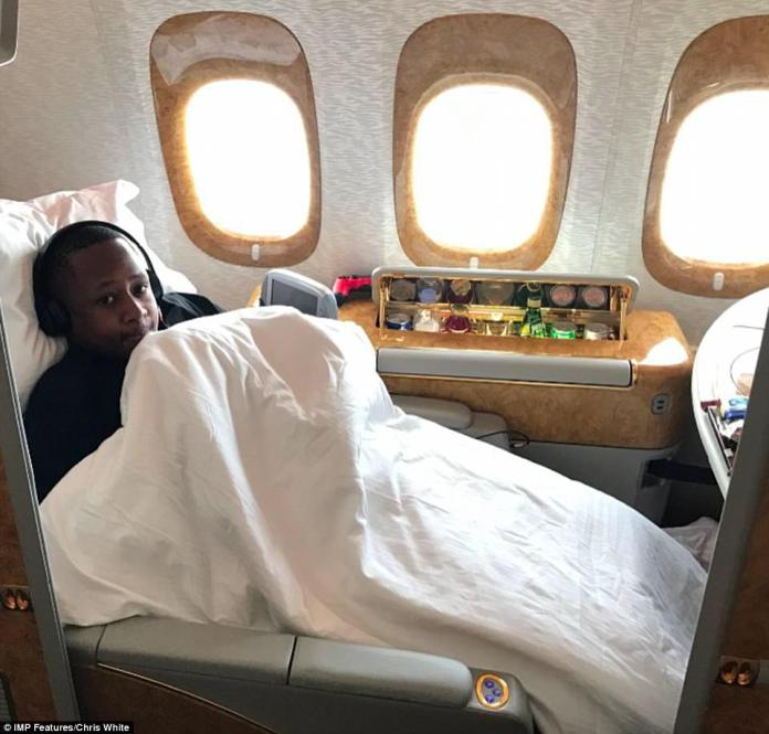 Sidney Hambira Jr, whose father is one of Zimbabwe's richest businessmen, even has a golden revolver that fires lipstick pellets. This picture next to an aircraft's minibar is taken from his Instagram