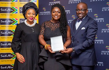 Dentaa Amoateng receives T.A.D's Honorary Award for Services to Community Development