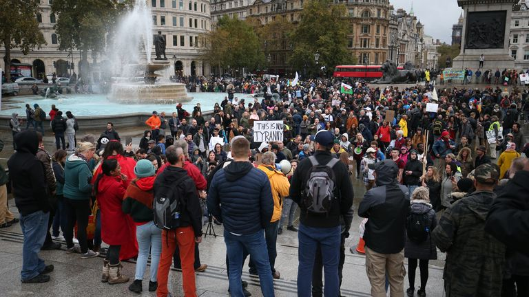 People protest against locking restrictions in Trafalgar Square