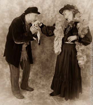 Ragpicker (Chris Irving) kisses Madwoman's hand (Janice Hansen)