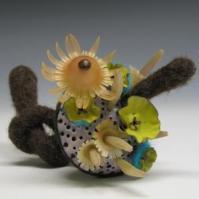 Natalya Pinchuk, Growth, brooch, 2006, plastic vegetation, wool, leather, enameled surfaces, plastic.