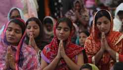 In this Nov. 14, 2011, photo, people from the Pakistani Christian community attend the Sunday service at St. Peter's church in Karachi, Pakistan. Pakistan's tiny and underfire Christian community thought big when constructing its latest church _ a domed, three-story building that towers over the sprawling slum it serves and is the largest yet in the violent, Muslim country. (AP Photo/Fareed Khan)