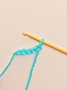 Chain five crochet stitches