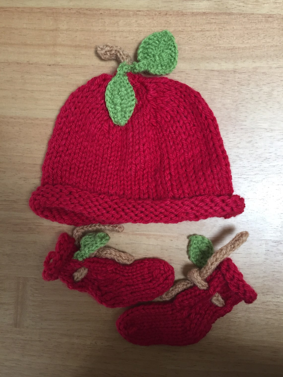 Handknit baby booties and baby hat