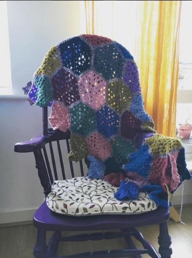 A patchwork granny crochet blanket