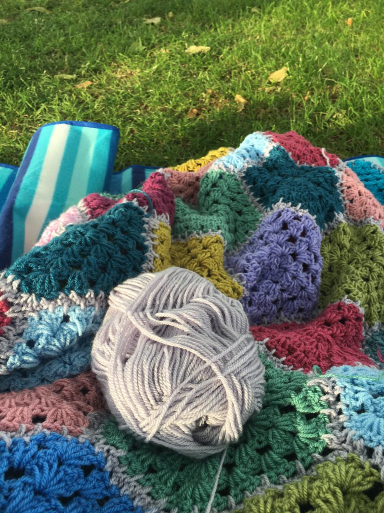 Crocheting in public - crocheting a blanket in the park