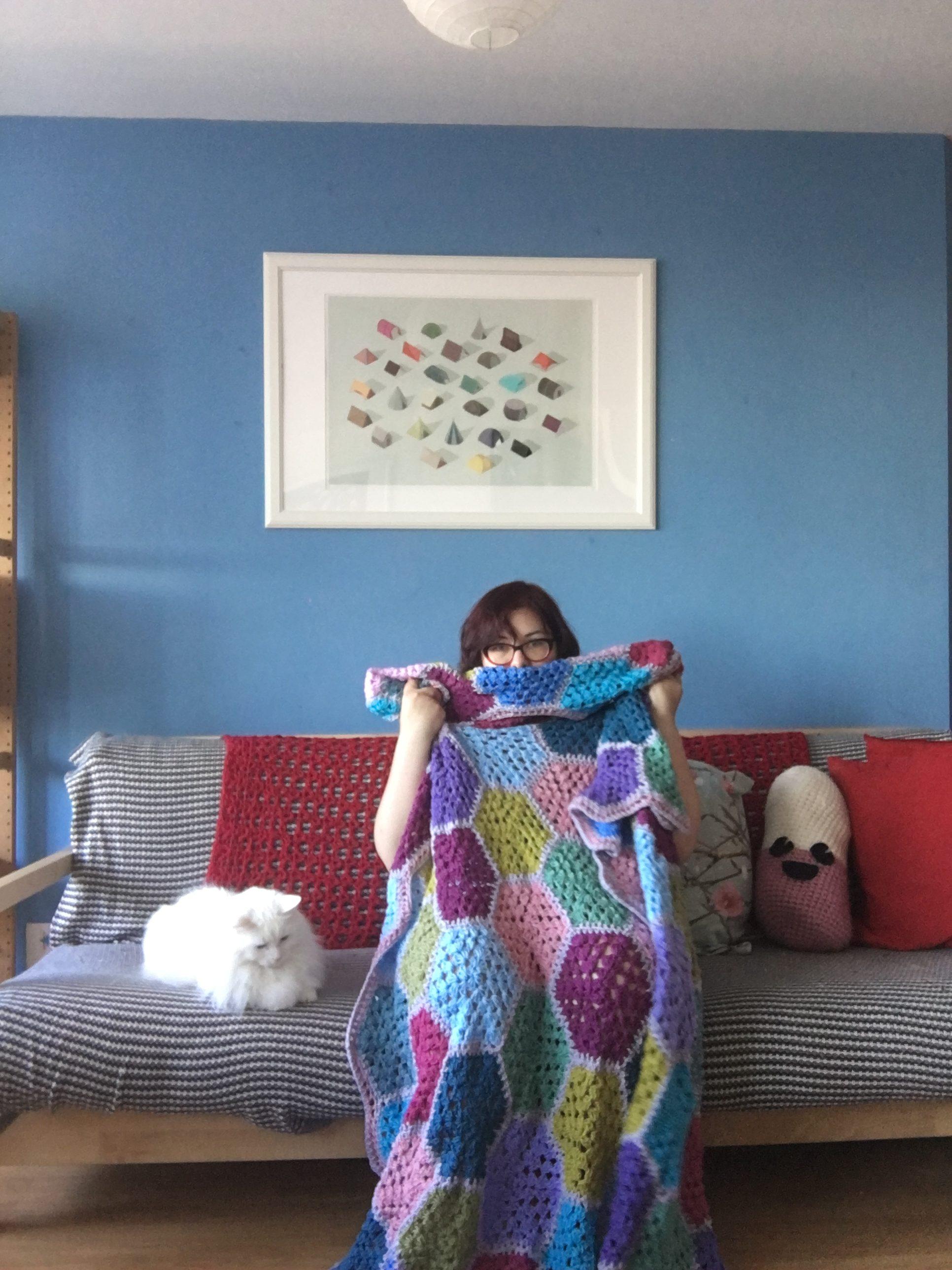 Granny square crochet blanket to snuggle under