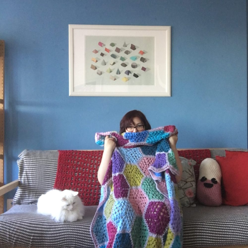 Granny square crochet blanket to snuggle under