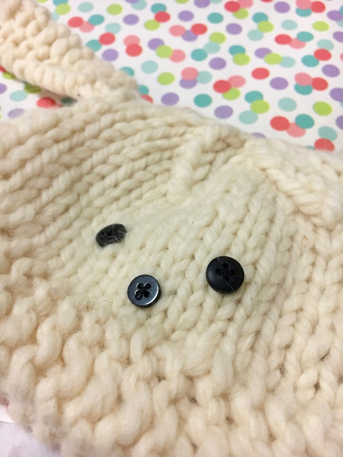 This Super quick baby hat has button eyes