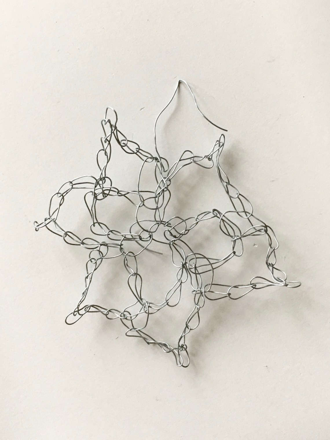 A simple crochet snowflake made of wire