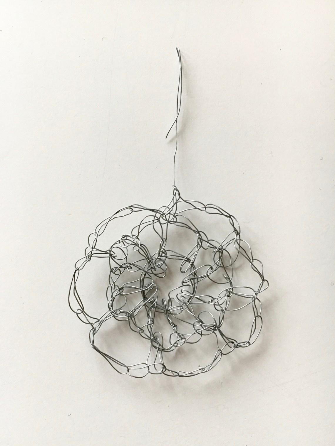 A crochet snowflake pattern which looks like a flower