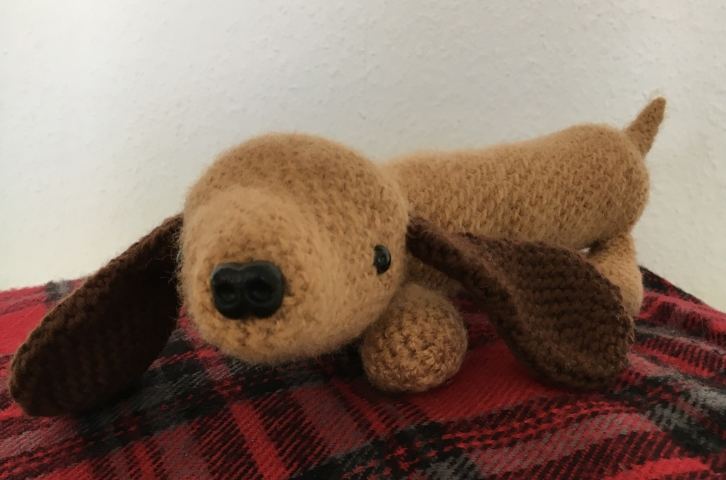 Crocheted amigurumi sausage dog with big floppy ears