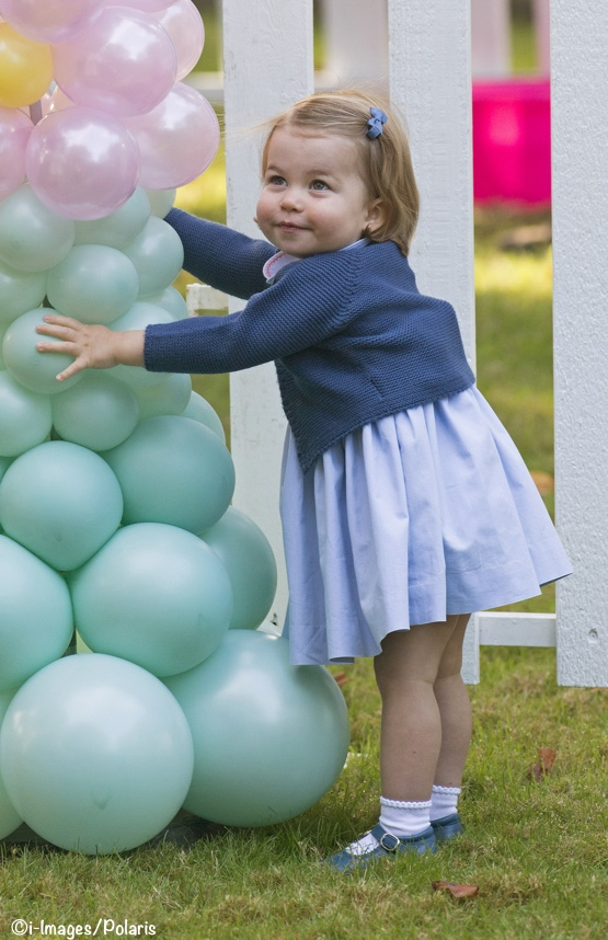 Princess Charlotte at a garden party in a dark blue cardigan
