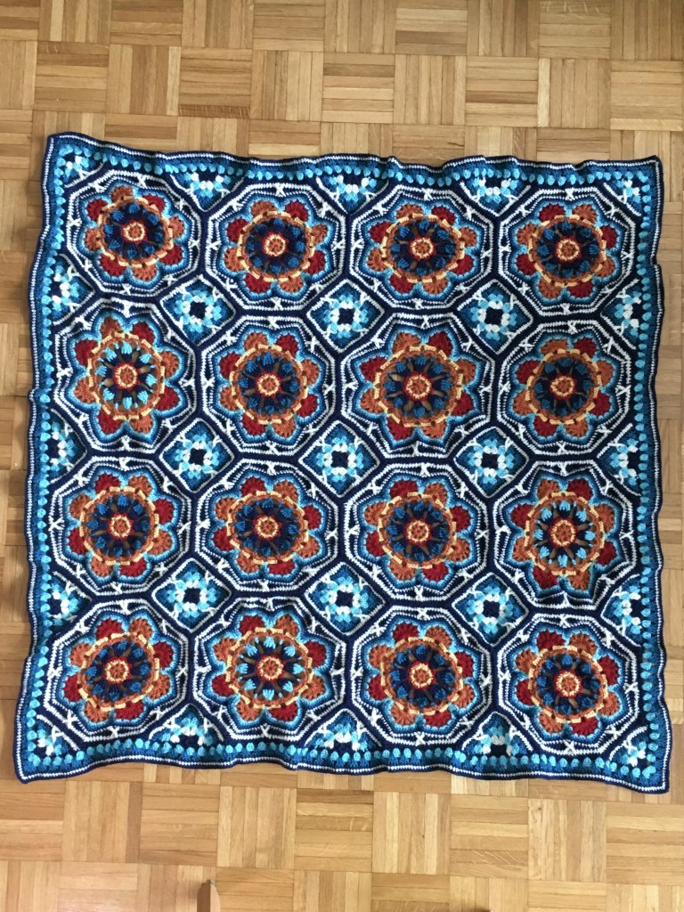 Persian Tiles Crochet Blanket spread out on the floor