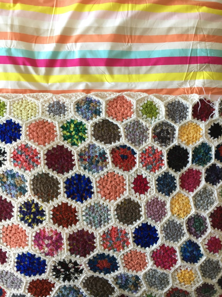 Granny Hexagon Crochet Blanket on colourful bedspread