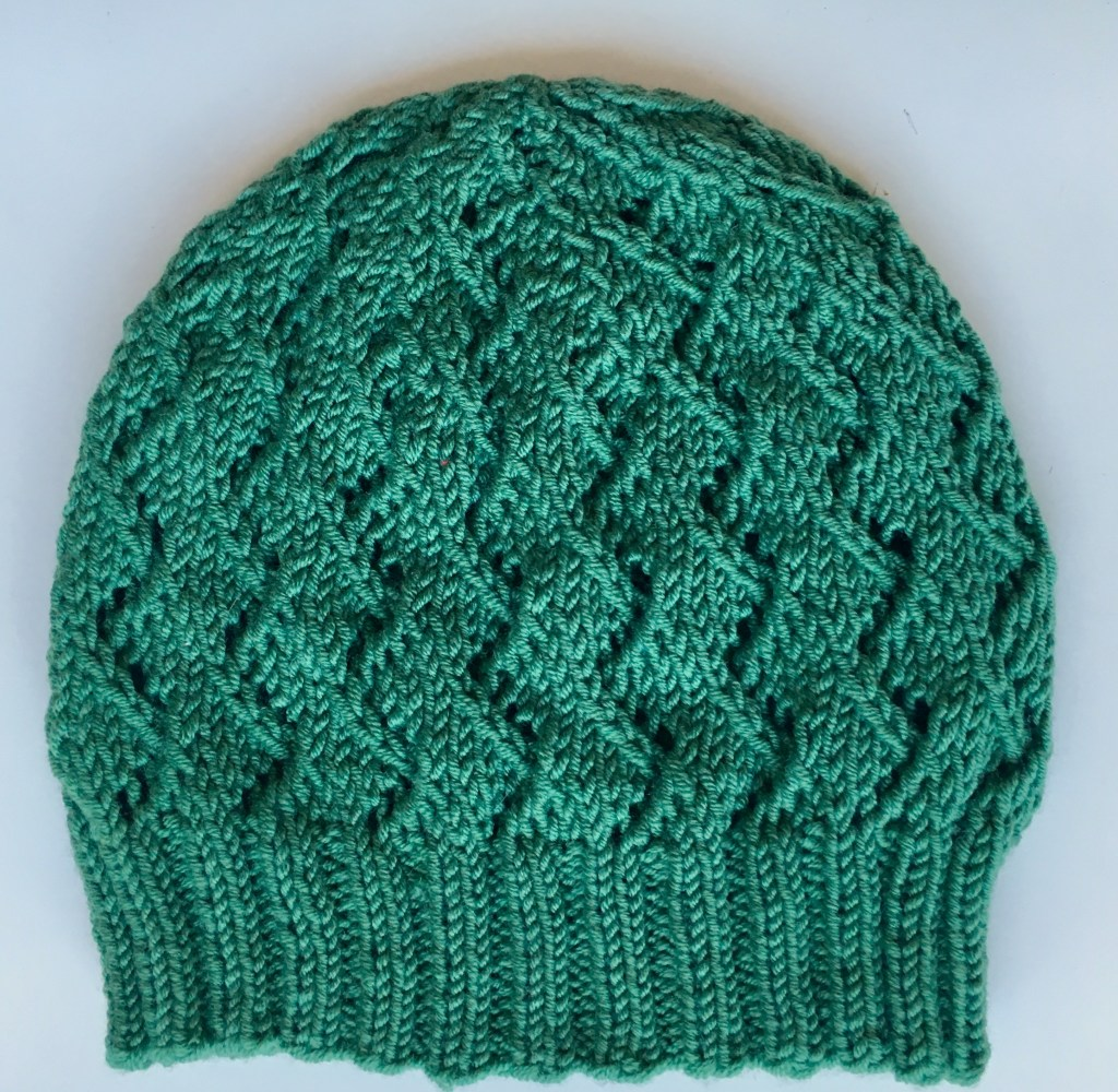 Forest green beanie with organic lace pattern