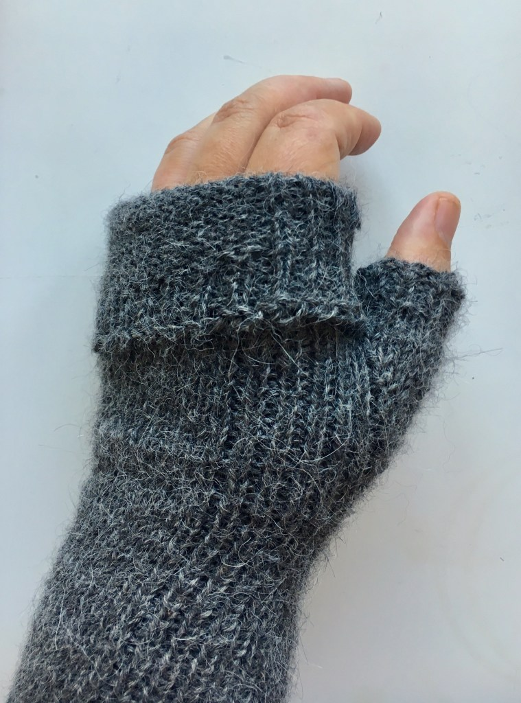 A finished fingerless mitt with the generous cuff folded down.