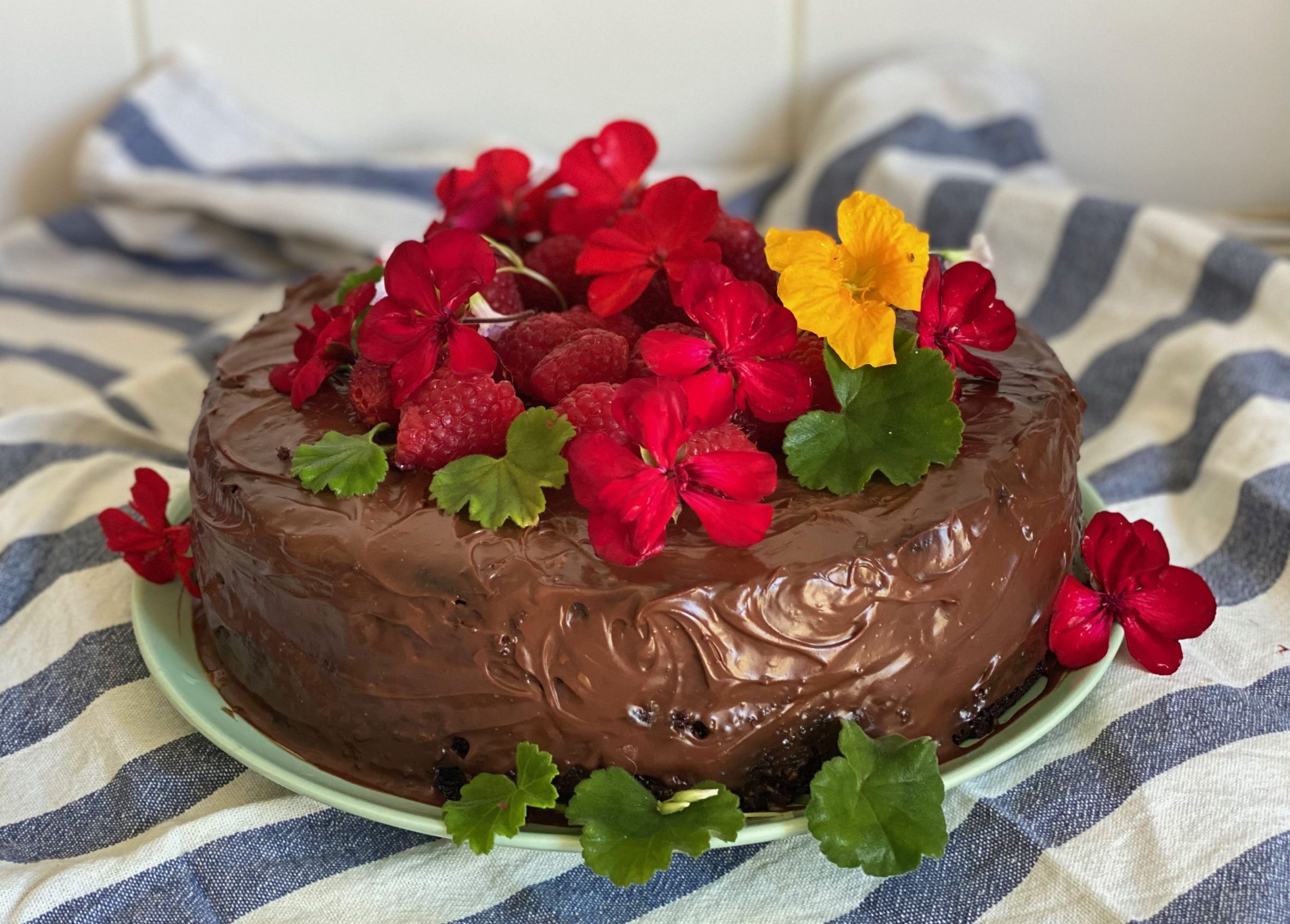 Best-ever vegan chocolate cake with vegan chocolate ganache & edible flowers