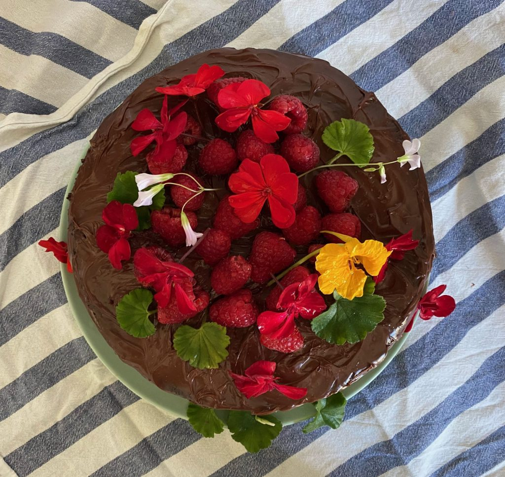 Edible flowers on a vegan chocolate cake
