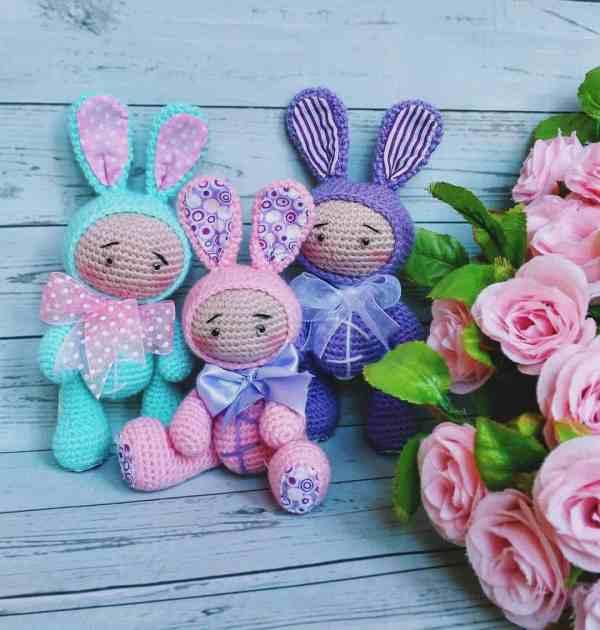 Amigurumi baby dolls in bunny costumes