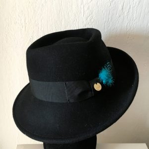 Black felt hat green feathers