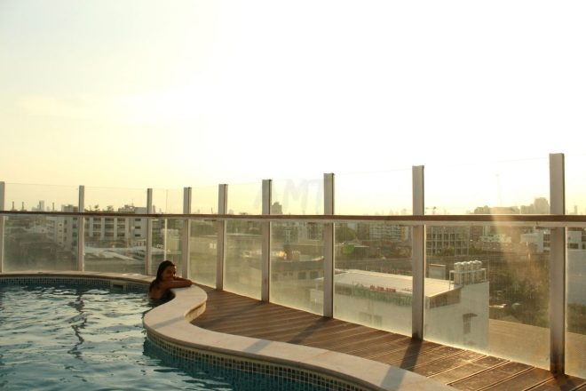 "Enjoying the sunset from ""our"" rooftop swimming-pool"