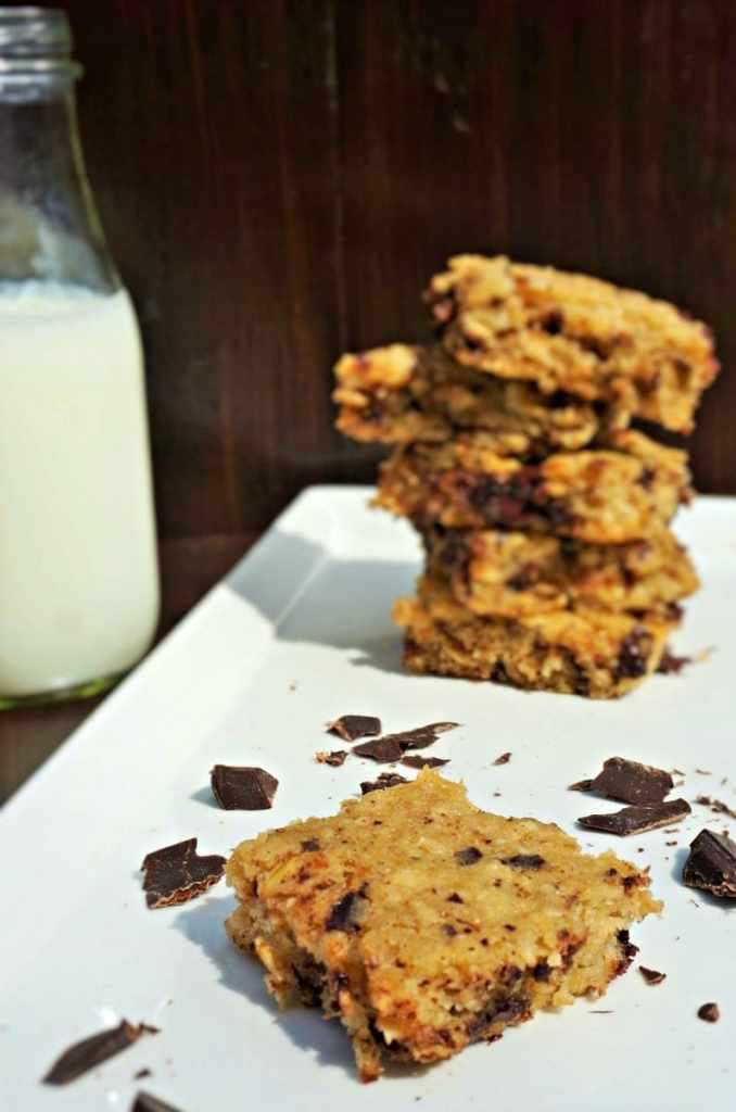A healthier oatmeal cookie bar that tastes every bit as decadent as a traditional bar cookie. These bars have been lightened up with Greek yogurt, coconut oil, dark chocolate, whole wheat, and are naturally sweetened. Shh! You don't have to let anyone know these are actually good for you!