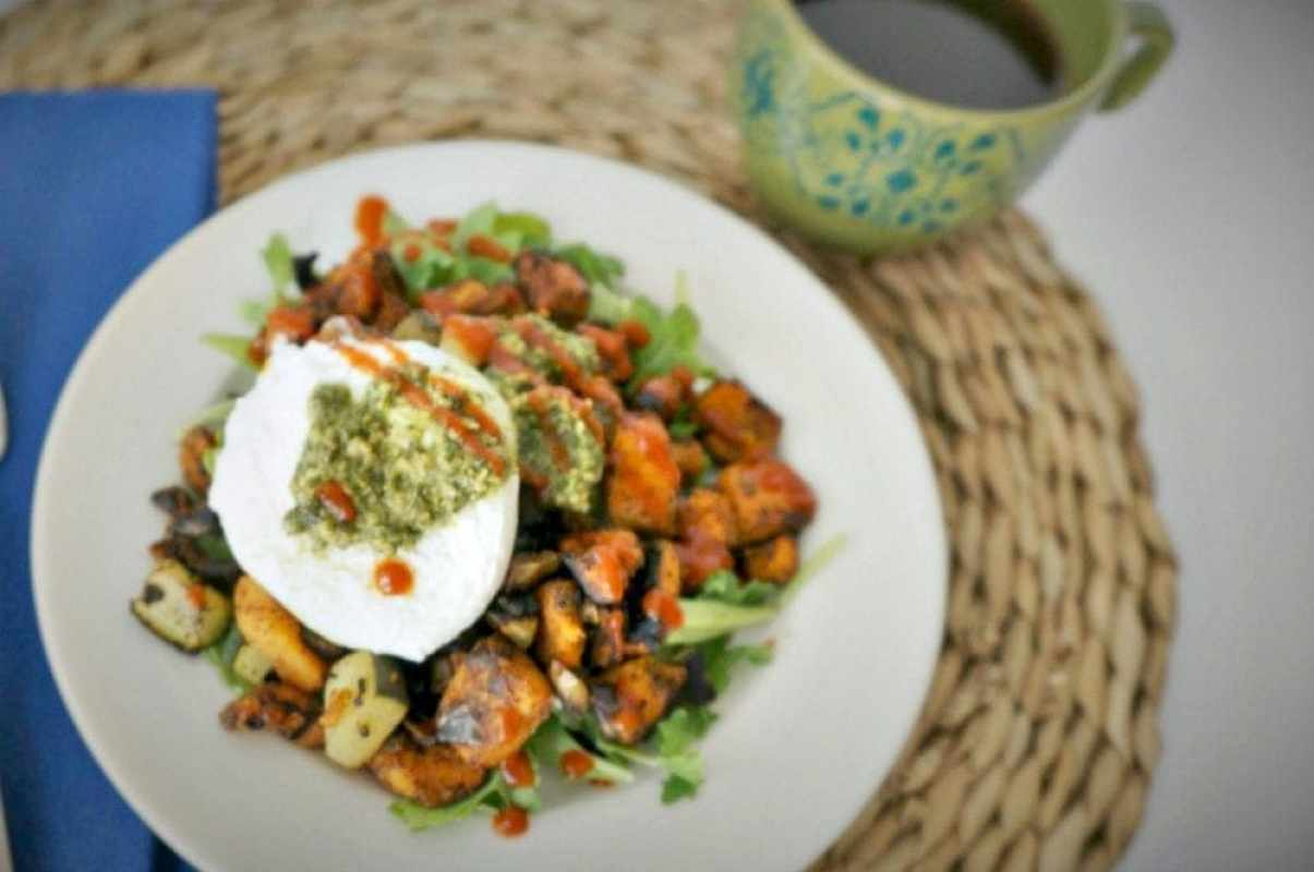 Southwestern Sweet Potato Hash with Cilantro Pesto: A traditional hash, spiced up with smoked chipolte and finished off with a poached egg and fresh cilantro pesto. Perfect for breakfast, brunch, lunch, or dinner. Paleo. Gluten-Free. Dairy-Free.