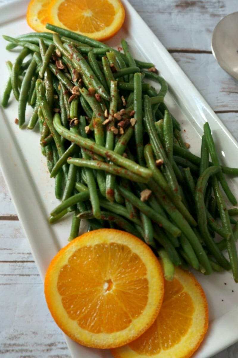 Sweet and Spicy Green Beans: Crisp green beans are tossed with a sweet and spicy pan sauce and topped with crunchy pecans, for a side dish that is easy enough for a weeknight meal but elegant enough for entertaining.