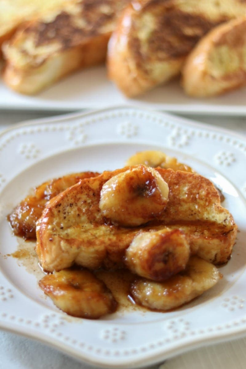 Bananas Foster French Toast: traditional french toast is given a spin with a rich topping of caramelized bananas.