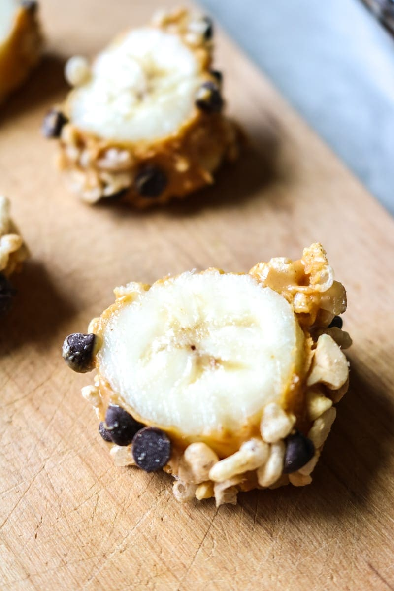 "Chocolate Peanut Butter Banana Sushi: Bananas are coated in peanut butter and dipped into a crunchy coating for a fun kid-friendly dessert ""Sushi."""