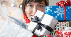 girl-with-load-of-christmas-gifts