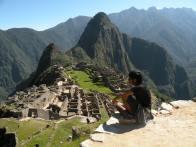 The sun shining on Machu Picchu