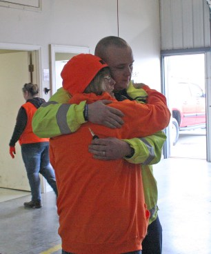 Kendra Peek/kendra.peek@amnews.com Sandra Hasty, mother of Michael Gorley, hugs her son-in-law, Charles Coffey before he heads out to search.