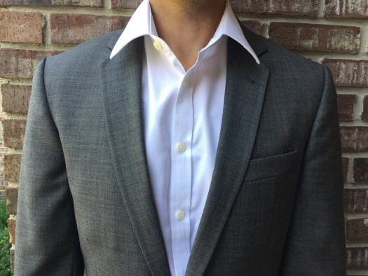 shirt collar outside suit jacket