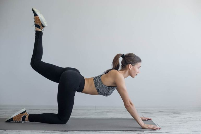 A Simple Pilates Workout Program That'll Really Fire Up Your Glutes