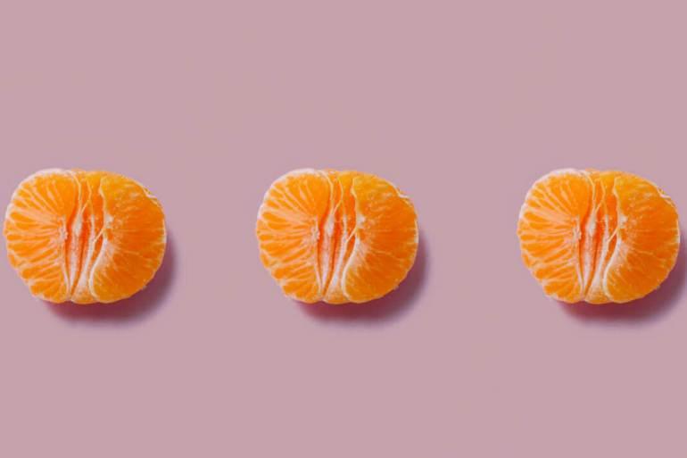 Three satsumas that resemble vaginas.