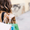 best european cities to shop in, woman holding shopping bag