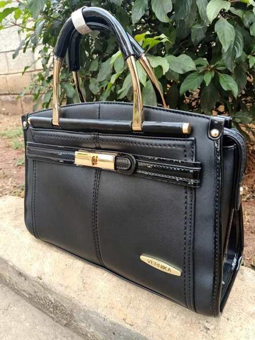 Black wetlook finish bag