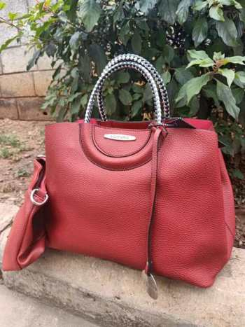 Red silver striped straps bag