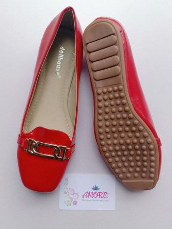 Red buckled doll shoe