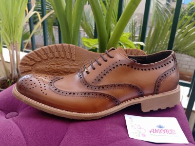 Light brown brogue with brown sole