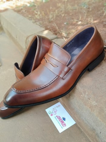 Brown pointed penny loafer