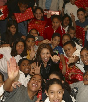 Thalia Joins Broadway Housing Project Children From The Robin Hood Foundation After School Program to Hand Out Holiday Gifts (1)