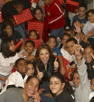 Thalia Joins Broadway Housing Project Children From The Robin Hood Foundation After School Program to Hand Out Holiday Gifts (10)