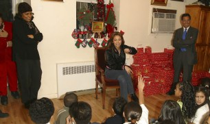 Thalia Joins Broadway Housing Project Children From The Robin Hood Foundation After School Program to Hand Out Holiday Gifts (12)