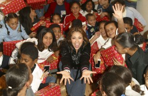 Thalia Joins Broadway Housing Project Children From The Robin Hood Foundation After School Program to Hand Out Holiday Gifts (15)