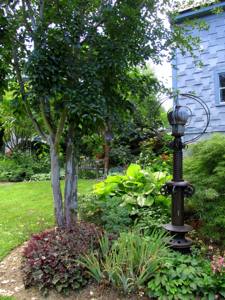 sculpture and plantings near studio