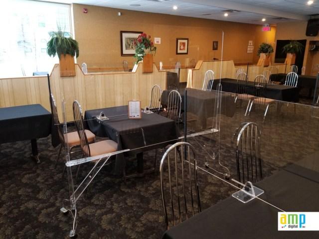 Protection hygiénique sur roulettes pour restaurants