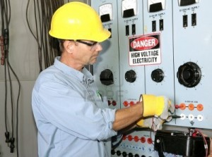 2163115-actual-electrician-working-on-an-industrial-power-distribution-center-all-work-shown-is-being-perfor